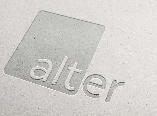 The Alter logo embossed in white paper.