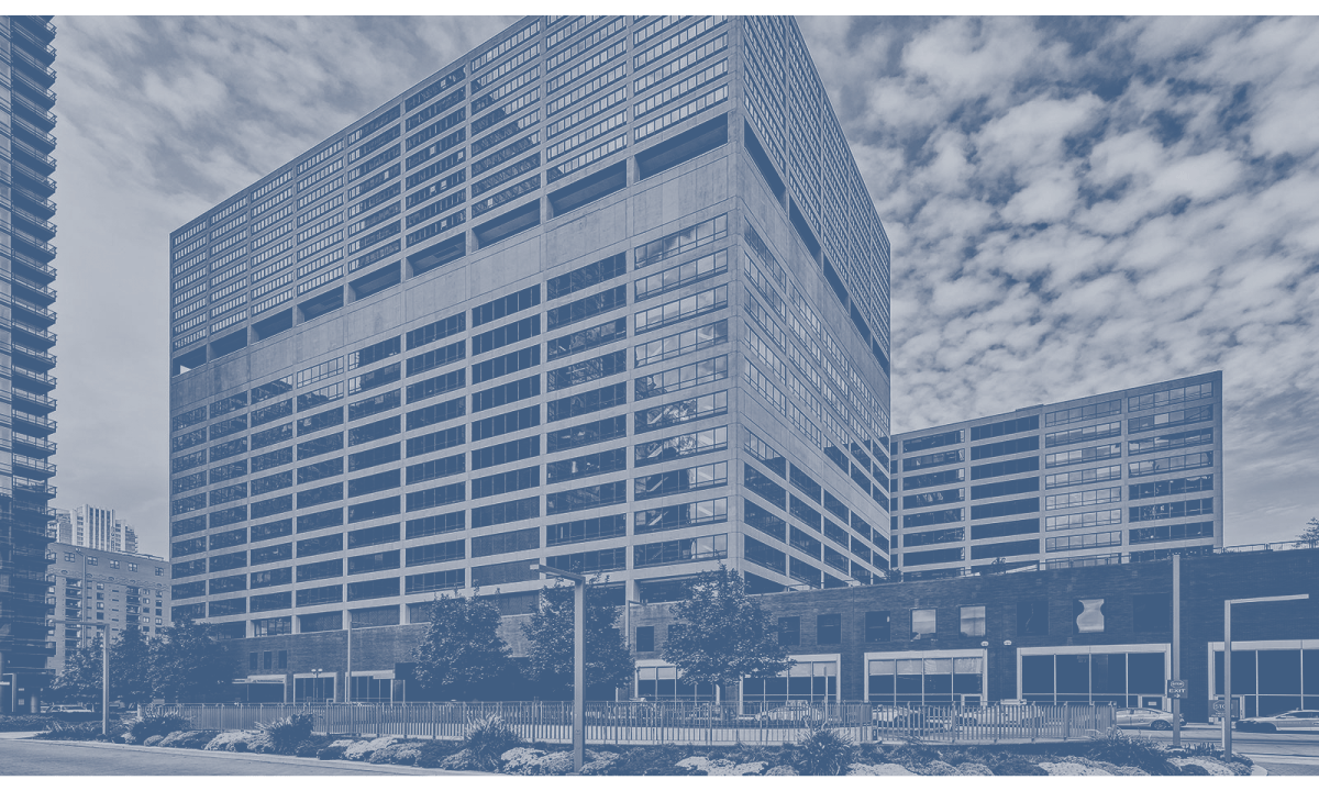 Blue duotone image of a building.