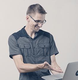Portrait of Florian Auckenthaler on a computer.