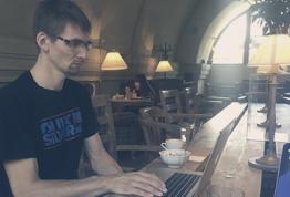 Florian Auckenthaler working on his computer.