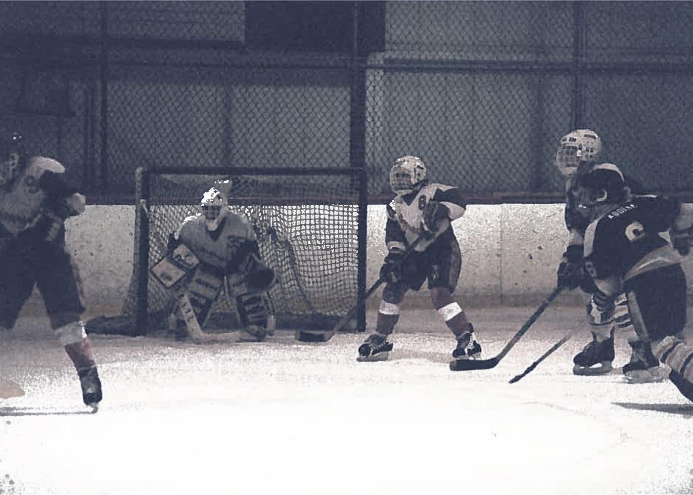 George Vavaroutsos playing hockey.