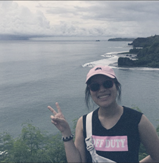 Shannon Lo on a mountain hill in Guam.