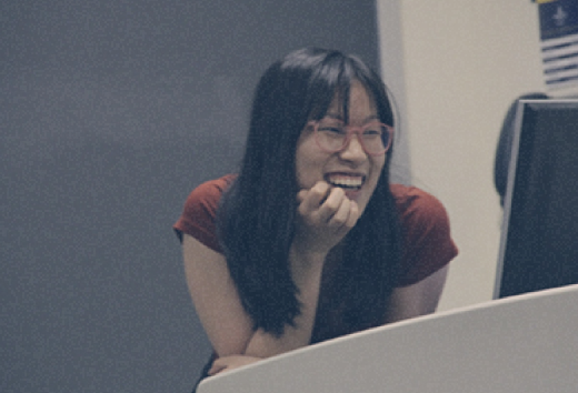 Shannon Lo smiling at a podium.