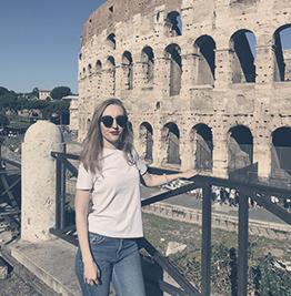 Valeria Kurolapova in front of the Roman Colosseum.